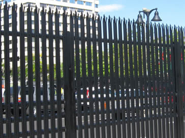 Black powder coated security palisade fence around a commercial place.