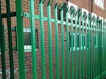 Blue powder coated palisade fencing with triple points.