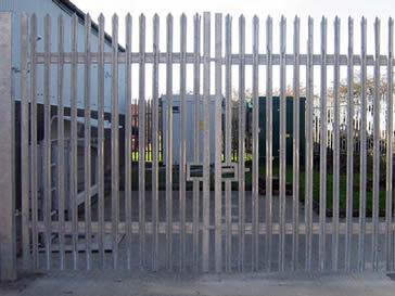 Galvanised palisade double-gate for a factory.