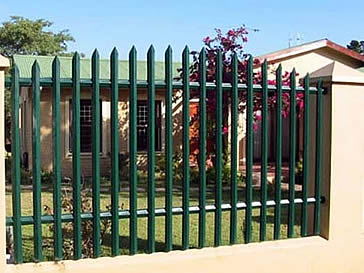 Green arch palisade fencing installed on the wall
