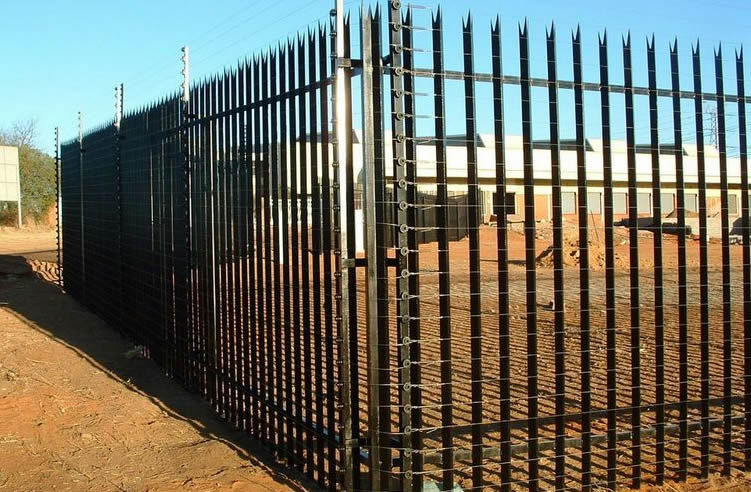 Industrial palisade fencing together with high tensile electric fencing for high security.