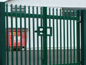 A factory with palisade fencing double gate - green powder coated