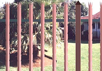 Red powder coated palisade fencing with 3-spiked top and razor spikes on each side of angle pale