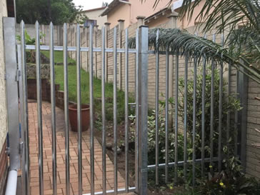 Galvanised palisade gate with one pointed head style for a common residential district.