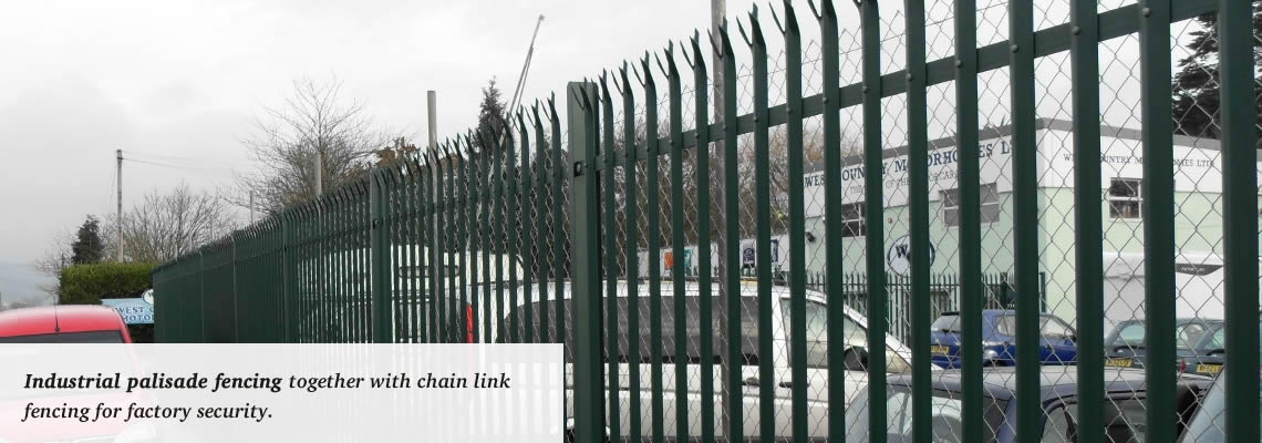 Industrial palisade fencing combined with chain link fencing