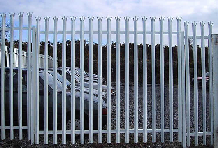 White angle steel palisade fencing for a commercial place.