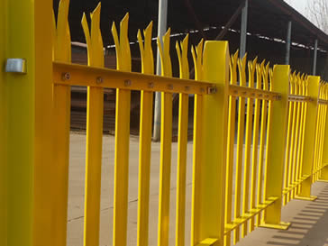 Yellow powder coated palisade fencing in our factory.
